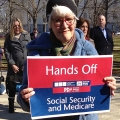 Photo of boomer holding Socl Security sign