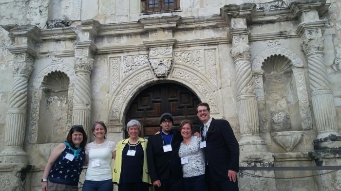 Photo of PhD students at Alamo